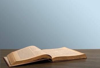Books. Open book on the desk