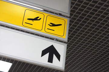 Arrival and departure signs at the airport