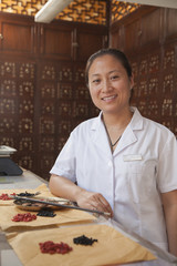 Chinese woman in traditional pharmacy
