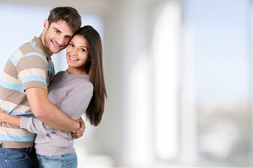 Summer. Beautiful affectionate couple smiling - isolated over a