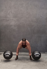 Caucasian weight lifter straining