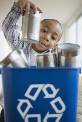 African American boy recycling aluminum cans