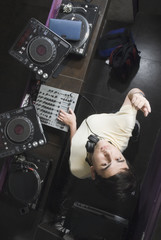 Hispanic DJ performing in nightclub