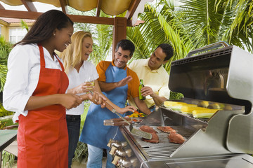 Multi-ethnic friends barbecuing
