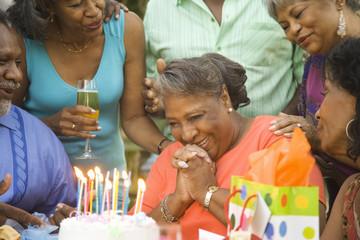 Senior African woman with birthday cake