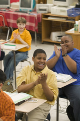 Students clapping in classroom