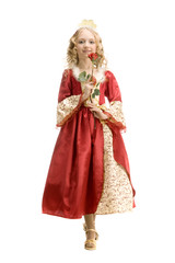 Beautiful little girl in princess costume standing with red rose