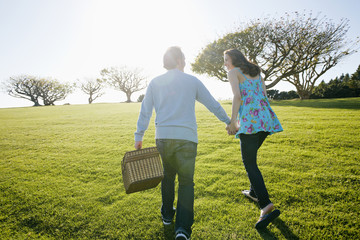 Couple having picnic in park