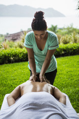 Woman receiving massage outdoors