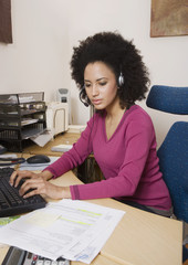 African businesswoman typing on computer