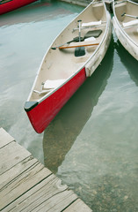 Canoes docked in lake
