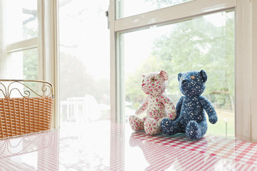Two hand made children's soft toys sitting on a table