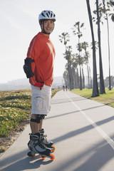 Asian man on rollerblades