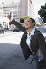 African businesswoman hailing a taxi
