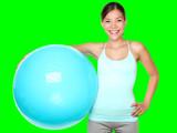 Fitness woman holding pilates ball - 82219042