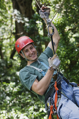 Man swinging on zip line