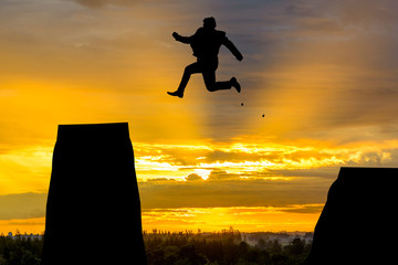 silhouette Man Jumping in sun rise.