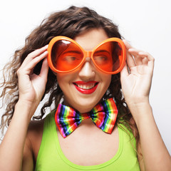 woman wearing big bright sunglasses