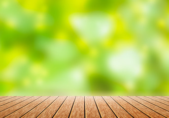 Wood table top with blur green nature bokeh