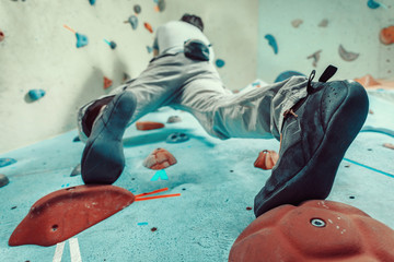 Man climbing artificial boulder
