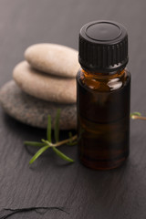 Essential oil with rosemary and fresh green leaves