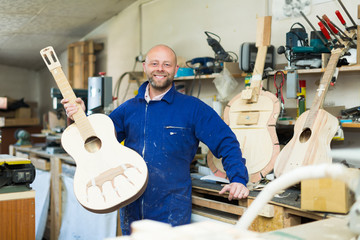 Guitar-maker at workshop