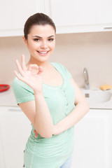 Young girl posing in kitchen