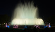 Постер, плакат: Evening view at colorful vocal fountain Montjuic