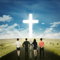 Businesspeople on the road with a cross