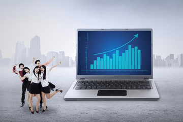 Businessteam and business chart on laptop