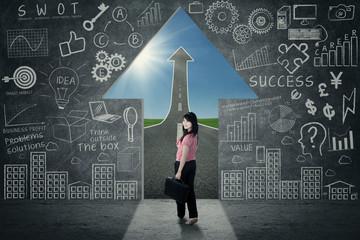 Businesswoman in opportunity door