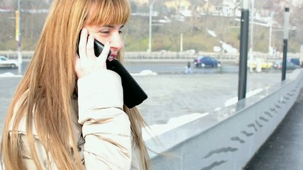 A young woman talks on her mobile phone