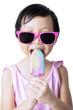 Child with sunglasses eats a fresh ice cream