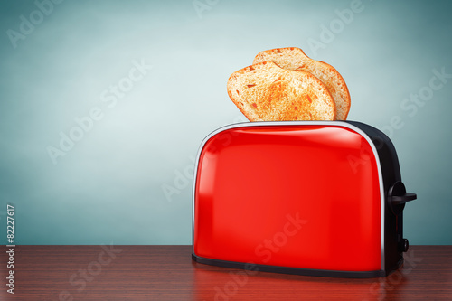 Old Style Photo. Toast popping out of Vintage Red Toaster - 82227617
