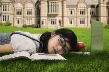 Cute student sleeping on the grass 1