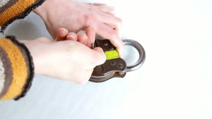 hands taking key and unlocking keypad