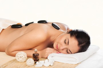 Spa. Stone massage for young woman at beauty spa salon