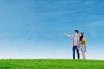 Happy couple in nature under blue sky