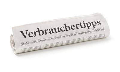 Zeitungsrolle mit der Überschrift Verbrauchertipps