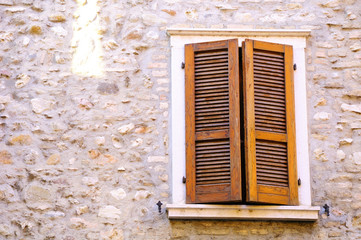 Shuttered window of old italian house in Verona.