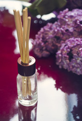 Aroma diffuser with bamboo sticks and lilac flowers