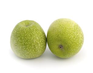 Granny Smith apples against white background..