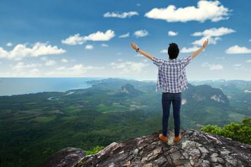Man enjoy fresh air at mountain peak