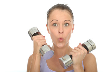 Healthy Young Woman Training With Weights Looking Shocked