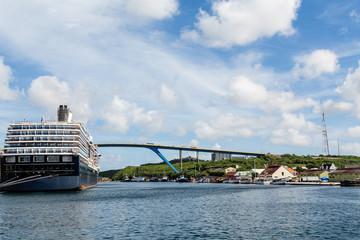 Massive Cruise Ship by Bridge in Curacao