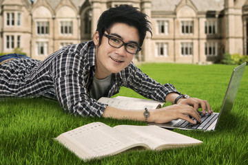 Smiling male student studying