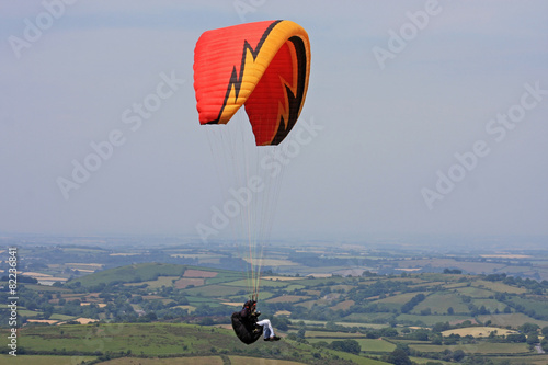 Leinwandbild Motiv paraglider over Dartmoor