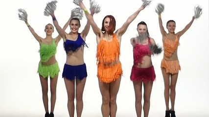 Girls dancing with pom-poms  synchronously in colorful dresses