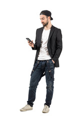 Bearded man with backward cap on the mobile phone