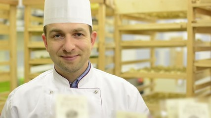chef or baker smiles to camera